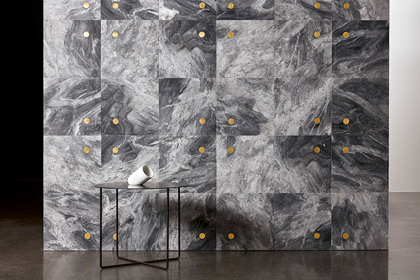 wall&floors- 'punto' wall covering with inlays in brass by andrea maffei architects
